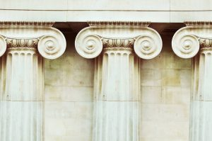 Three antique columns in doric style closeup